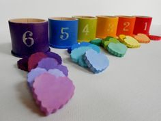Child's wooden hearts montessori waldorf counting numbers sorting color matching game toy bucket of hearts. $29.00, via Etsy.