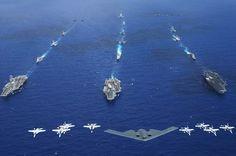 "Porta-Aviões: 1. ""USS Kitty Hawk""; 2. ""USS ROnald Reagan"". 3. ""USS Abraham Lincoln""; 4. ""Caças""; 5. ""Bombardeiro B-2 Spirit""."