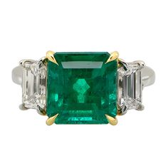 5.07 Carat Emerald Diamond Gold Platinum Ring | See more rare vintage Three-Stone Rings at http://www.1stdibs.com/jewelry/rings/three-stone-rings