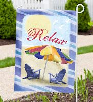 Hummingbird garden flag with coordinating stand from Evergreen