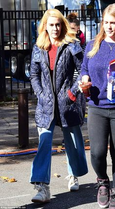 Ready for action:Later, she swapped her bathrobe for a thigh-length blue coat, straight leg jeans and some fashionable wedge trainers with wide laces
