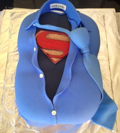 Superman birthday cake complimented with an 'Kryptonian Identity' personalized book. The 'happy birthday' collar, tie and book can be kept as a souvenir in an airtight container forever :)