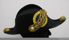 Chamberlain's Ceremonial cocked hat belonged to Erik Torstensson Uggla (born in 1906 in Lund), Groom of the Chamber (Kammarjunkare) in 1953, Chamberlain (Kammarherre) in 1959, Herald of the Orders of H.M. the King (1961-1974), also President of the Rotary Club of Vänersborg (1950-1951) and honorary fellow of Western Sweden's genealogy association. He was married to Birgit Kjerrulf. Bequeathed by Erik T:son Uggla to the Vänersborg Museum. Presented by his son Arvid Uggla.