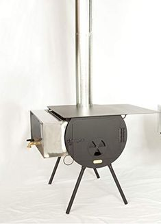 This Cylinder Stoves Outfitter Wood Stove Package is a quality product that includes all the features you need for tent heating and cooking. Keep reading. Living Room Tv Cabinet, Ikea Living Room, Living Rooms, Stove Paint, Tent Stove, Cold Weather Camping, Fireplace Tv Wall, Wall Tent, Cool Tents