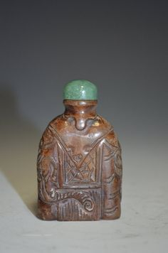 Old Chinese Carved Jade Snuff Bottle. H: 2 1/4 Inches