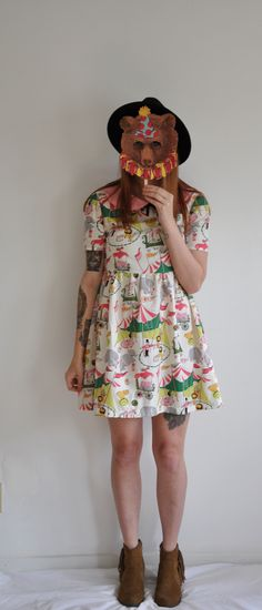 Come one, Come all! To the sighting of the cutest dress around. Features an adorable vintage inspired circus print. Sweet details include a peter pan collar, black velvet bow, mid-length sleeves and a gathered skirt. The perfect dress for any fun filled adventure! --ZIpper closure in back  Siz...