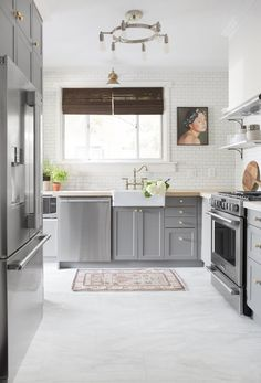 White and Grey Kitchen Cabinets. White and Grey Kitchen Cabinets. before and after A Small Pittsburgh Kitchen Gets A Vinyl Flooring Kitchen, Luxury Vinyl Tile Flooring, Kitchen Vinyl, Kitchen Tiles, New Kitchen, Kitchen Decor, White Flooring, Floors Kitchen, Concrete Kitchen