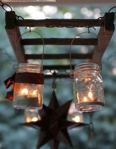 Mason jars hanging from an old ladder ... love the Moravian Star!