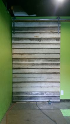 Made and installed this slider barn door with salvaged poplar siding.