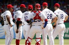 Aug 14, 2016; Arlington, TX, USA; Texas Rangers third baseman Adrian Beltre (29) and shortstop Jurickson Profar (19) and second baseman Rougned Odor (12) and catcher Jonathan Lucroy (25) and manager Jeff Banister (28) and first baseman Mitch Moreland (18) wait for a relief pitcher to enter the game in the seventh inning against the Detroit Tigers  at Globe Life Park in Arlington. Mandatory Credit: Tim Heitman-USA TODAY Sports