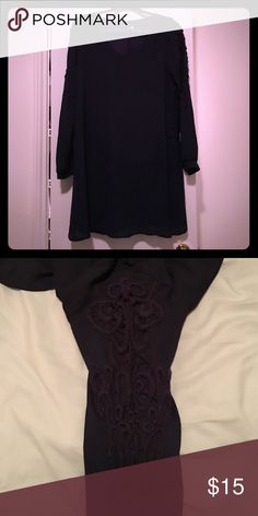Navy blue dress Long sleeved- light weight navy blue dress. The arms have a cut out lace pattern on them. The dress hits mid thigh Dresses