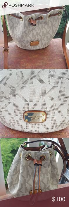 Michael Kors cross body bag Michael Kors small white cross body bag. Used once! In GREAT shape! Michael Kors Bags Crossbody Bags