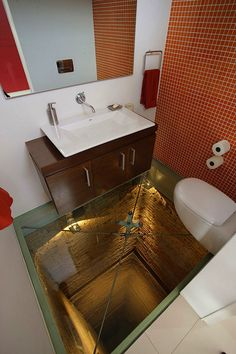 High-End Penthouse in Mexico with Glass Floor Toilet. How could you use the bathroom knowing you could that deep!