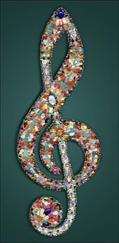 Treble clef made with gemstones.