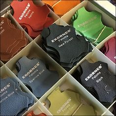 """If you offer top-of-the line leather upholstery in near unlimited colors it pays to display choices as with these Leather Hide Fabric Color Samples by Ekornes. And shaped like a cow hide they immediately say """"leather. Color Swatches, Fabric Samples, Fabrics, Packaging, Business, Leather, Inspiration, Furniture, Ideas"""