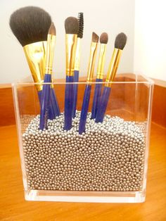 I love this Idea for all my makeup brushes. I think I'll hit Hobby Lobby this weekend and buy some cool beads or maybe colored stones.