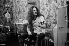 Keyboard player Ken Hensley from English rock band Uriah Heep posed lighting a cigarette backstage in London in February 1980.