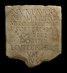 """Fragment of a Roman building inscription. The inscription on the marble reads: """"To the spirits of the Emperors and to the god Mars Camulus, Tibernius Celerianus, citizen of the Bellovaci, moritux of the people of London, first... - to set up this monument"""". This fragment was found at Tabard Square, Southwark, carefully buried in the temple courtyard.    Date  300 AD - 350 AD"""