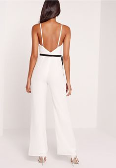 Take the plunge and dare to bare in all the right places in this babin' jumpsuit. Showcase your curves with its fresh white hue, sexy plunge neckline,…