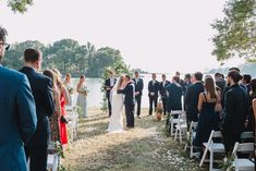 Waterfront wedding, southern maryland wedding, bride and father, blue and navy wedding, simple aisle.