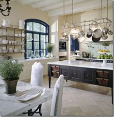 French manor-inspired estate for sale just north of Chicago that has a kitchen of all time in it. The kitchen was designed by Mick DeGiulio.  http://harmonyandhome.blogspot.com/2010/05/illinois-estate-for-sale.html