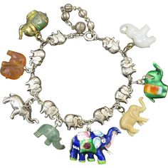 Carved Gemstone and Enamel Elephant Charm Bracelet in Sterling from raretreasures on Ruby Lane Ruby Bracelet, Charm Bracelets, Elephant Jewelry, Elephant Love, Silver Jewelry, Unique Jewelry, Vintage Costume Jewelry, White Gold Diamonds, Wedding Jewelry