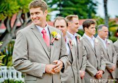 Light suit, coral tie