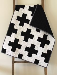 black and white cross quilt.