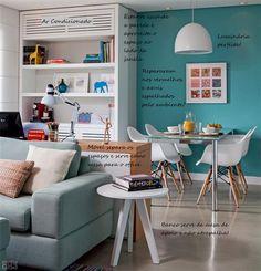 Móvel que divide os ambientes e funciona como escritório.