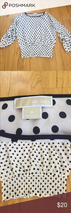 Michael Kors polka dot top I hate parting with this top but it's just too short on me! It's a petite and I can't wear petite, I have a very long torso! Love this though. Goes awesome with black pants/skirt or with jeans! It's so versatile! Smalllllllll black mark on front as seen in pic. Very tiny! MICHAEL Michael Kors Tops Blouses