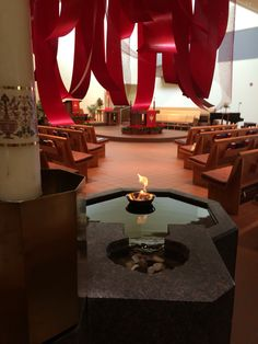 Pentecost Sunday red ribbons hang from sky light fire floats in baptismal font water during Acts reading. Sacred Architecture, Church Architecture, Modern Church, How To Make Fire, Pentecost, Church Building, Sacred Art, Worship, This Is Us