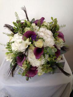 Purple calla lilies, white hydrangeas, lissianthus, roses and foliage