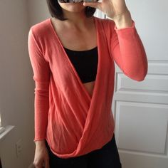 DVF CORAL ISSIE SWEATER So soft and perfect.. I wish this had a care label so I could tell you what the knit is. No wool and is the opposite of itchy. These are the softest sweaters I own. I have 3 others in the same knit. This is a beautiful twist front pullover sweater. Designer sample. Lightly worn. Sample size S, but could fit a M Diane von Furstenberg Sweaters