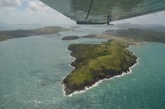 Looking down at the whitsundays, from the window of a Cessna