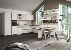 Modern kitchen #First with doors in melamine white limed oak and cappuccino brown soft. #Worktop in laminate cappuccino. Cucine modern #modernkitchens #cucineconpenisola #peninsulakitchens #cucineangolari #Snaidero