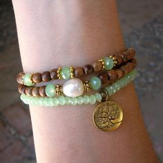 Mala bracelet stack, agate green crystal, a genuine freshwater pearl charm, and a tree of life charm.  #lovepray #jewelry