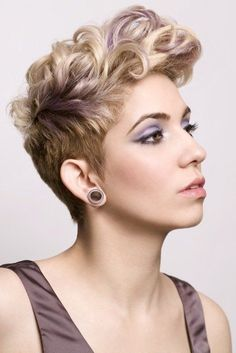 Curly or wavy faux hawk haircut. Love the soft purple highlight.