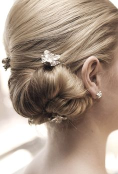 Chignon with floral hairpins. Photo by Edyta Szyszlo.