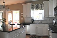 Kitchen Redos On a Budget | You can learn how to make the faux roman shade here .