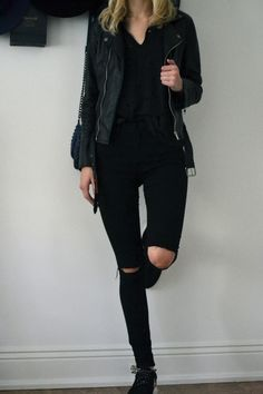all black. knee cut skinny jeans.