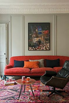 I can't believe I just bought a red couch. Will be looking for inspiration from rooms like these