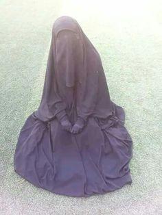 Beautiful Muslimah sitting on the grass