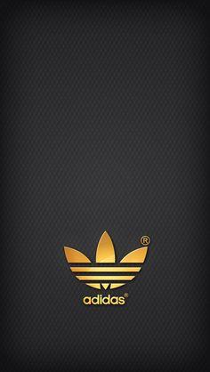 Golden Adidas on grey background.