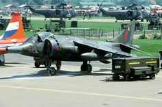 """A Royal Air Force Harrier aircraft of No. 233 OCU parked on the flight line during """"Air Fete at RAF Mildenhall, Suffolk (UK), 9 June Fighter Aircraft, Fighter Jets, British Aerospace, Close Air Support, Military Jets, Royal Air Force, Air Show, Aviation, Scenery"""