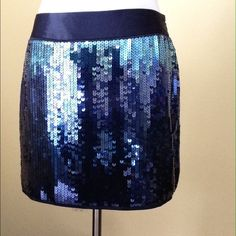 Express: Blue ombré  sequin mini skirt. Celebrate the beautiful blues of Spring 2015. If you love color and shine then this is the flirty skirt for you. Express Design Studio size 2. Never worn, perfect condition. Express Skirts Mini