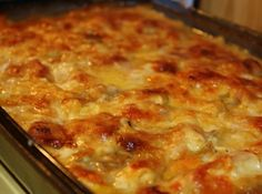 Homemade Ham and Scalloped Potatoes -- butter, flour, milk, salt and pepper, onions, potatoes, ham, cheddar