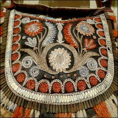 Pitt Rivers no.142 | Flickr - Photo Sharing!  Comment:  I am guessing this is Wendake as the floral embroidery is very naturalistic and highly detailed while the surrounding geometry and trim shows Western Great Lakes style.