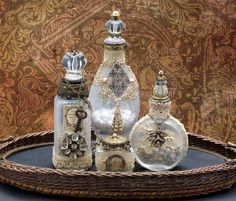 My altered bottles using antique lace, bottles, and beads from my private collection.