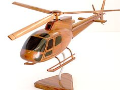 This handcrafted model of the A-Star 350 Helicopter makes a great addition to desktop or accent table. With remarkable detail, this scale replica has multiple coats of polyurethane finish for added gloss and rich wood grain. Wooden Airplane, Wooden Toy Cars, Wood Toys, Intarsia Woodworking, Woodworking Toys, Woodworking Projects, Electric Hand Drill, Wood Gifts, Wood Design
