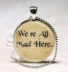 I found 'Alice In Wonderland Necklace We're All Mad Here Book Quote Glass Bezel Fairy Tale Art Pendant with Ball Chain Included (ITEM B003)' on Wish, check it out!